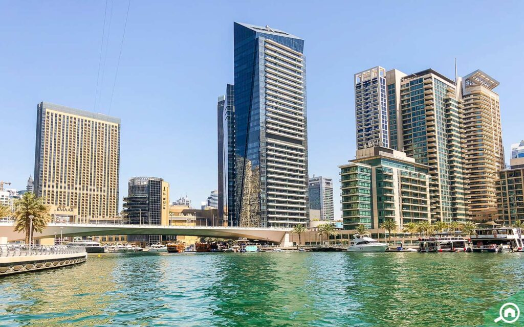 Waterfront view of residential and commercial buildings in Dubai Marina