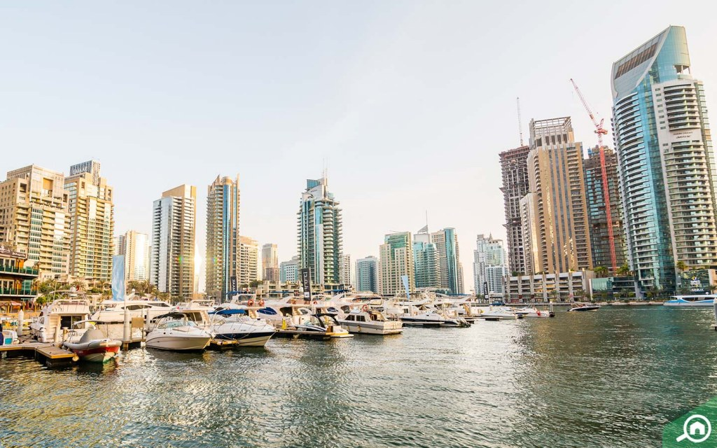 Buildings and yachts in Dubai Marina , one of the expensive areas to live in Dubai