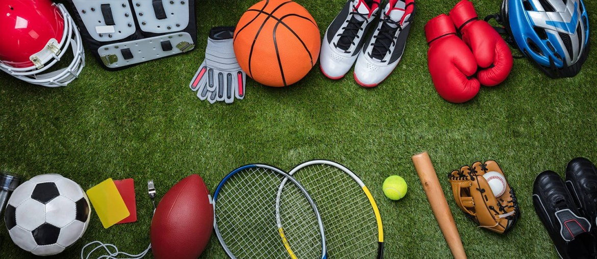 Various sports equipment on grass