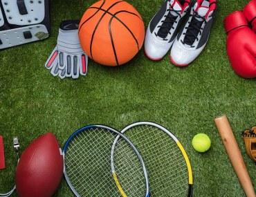 Various sports equipment on grass