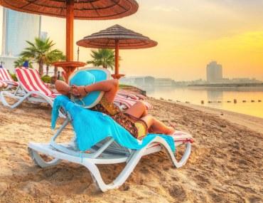 sunrise on a beach in Dubai