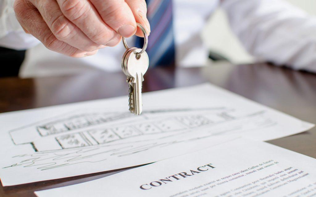 Man handing over keys to rental property in Dubai