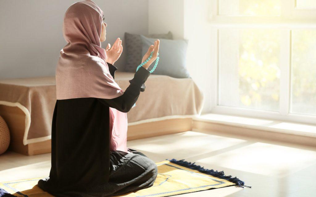 Woman offering Eid prayers in Dubai  at home for Eid 2020 in Dubai