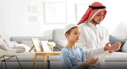 father and son offering eid prayer at home