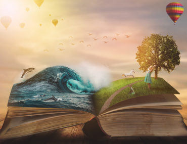 Open book showing different landscapes