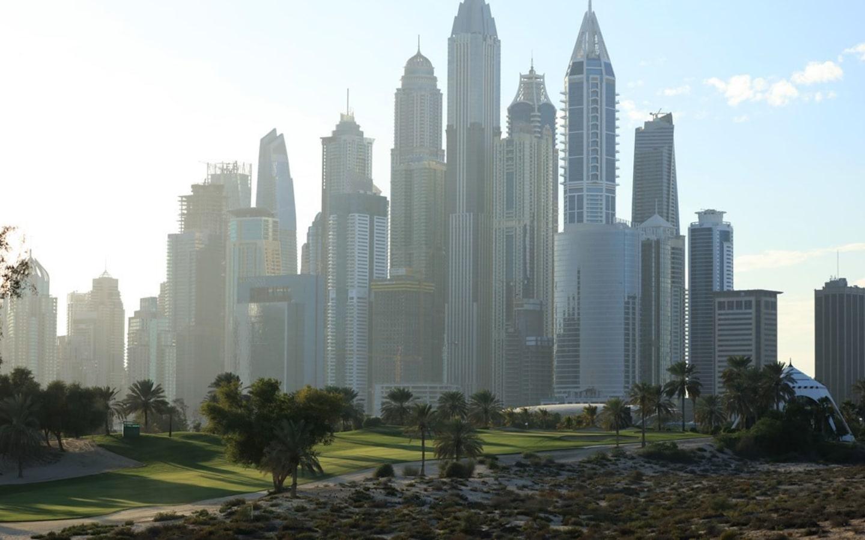 View of Emirates Golf Club and Dubai marina skyline