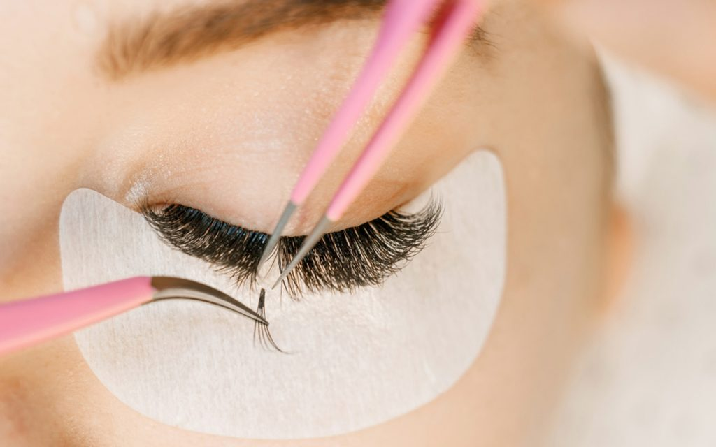 Woman undergoing an eyelash extension treatment at a salon in Dubai