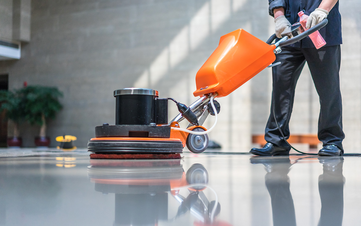 Man cleaning the floor, part of the facility management services in Dubai