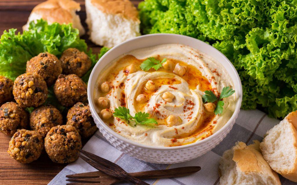 Bowl of of hummus with falafel