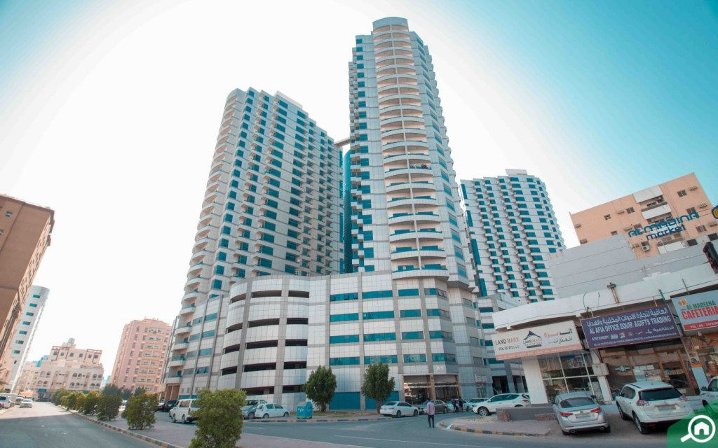 View of Falcon Tower buildings in Ajman Downtown