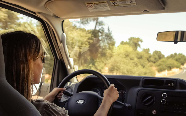 Female US citizen driving a car