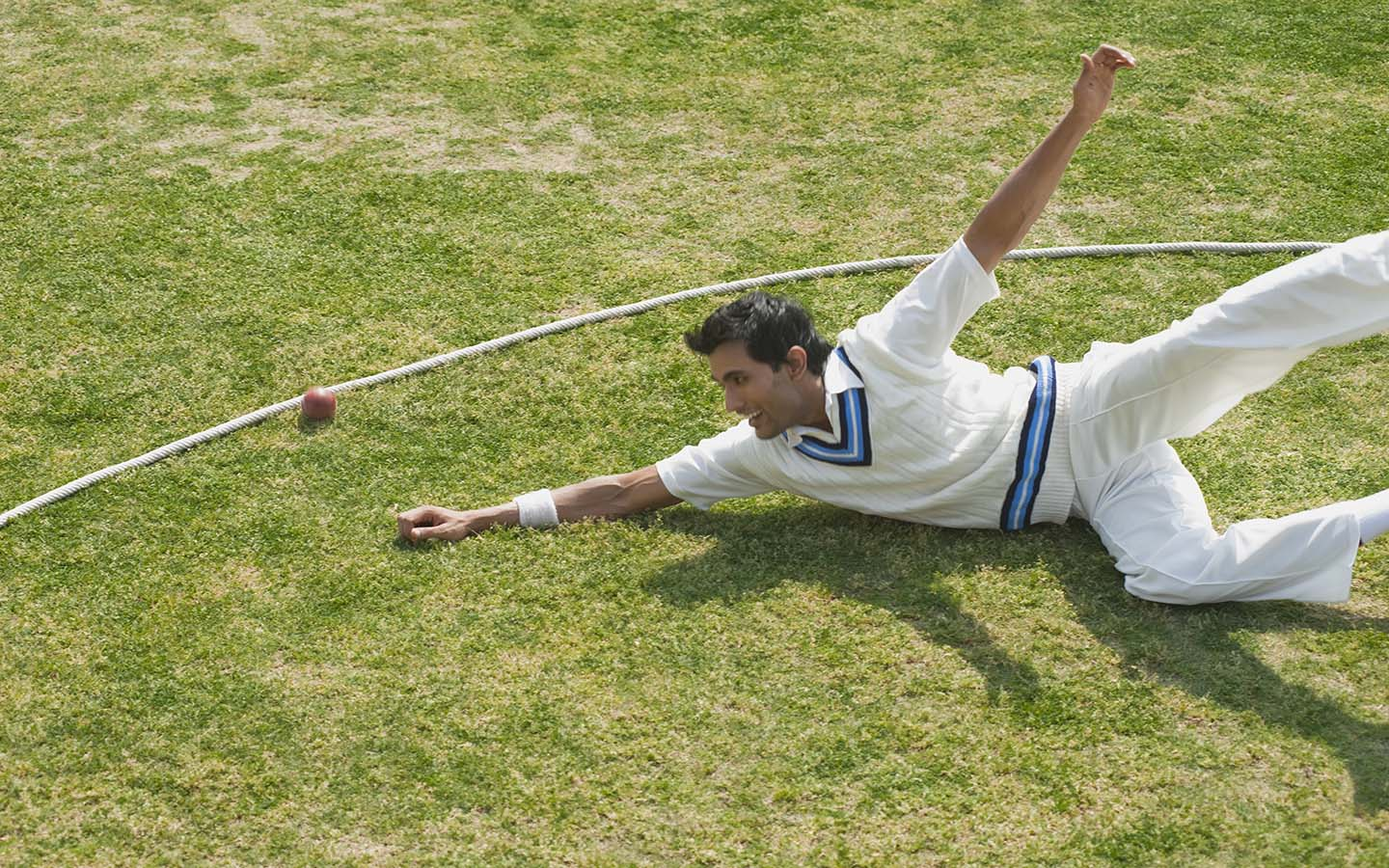 Fielder striving to save a boundary