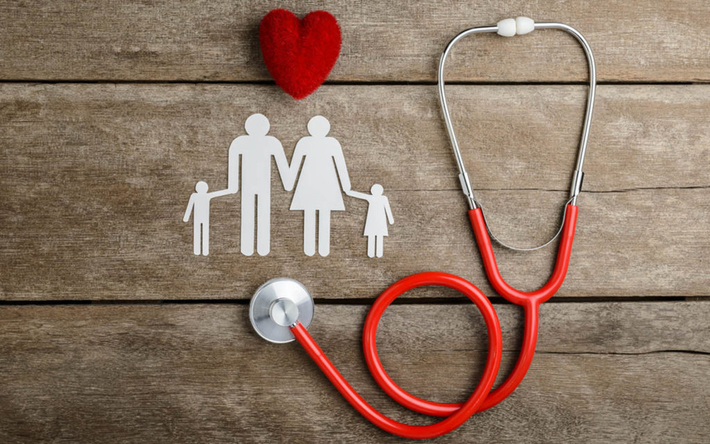 Figure of family with heart and stethoscope