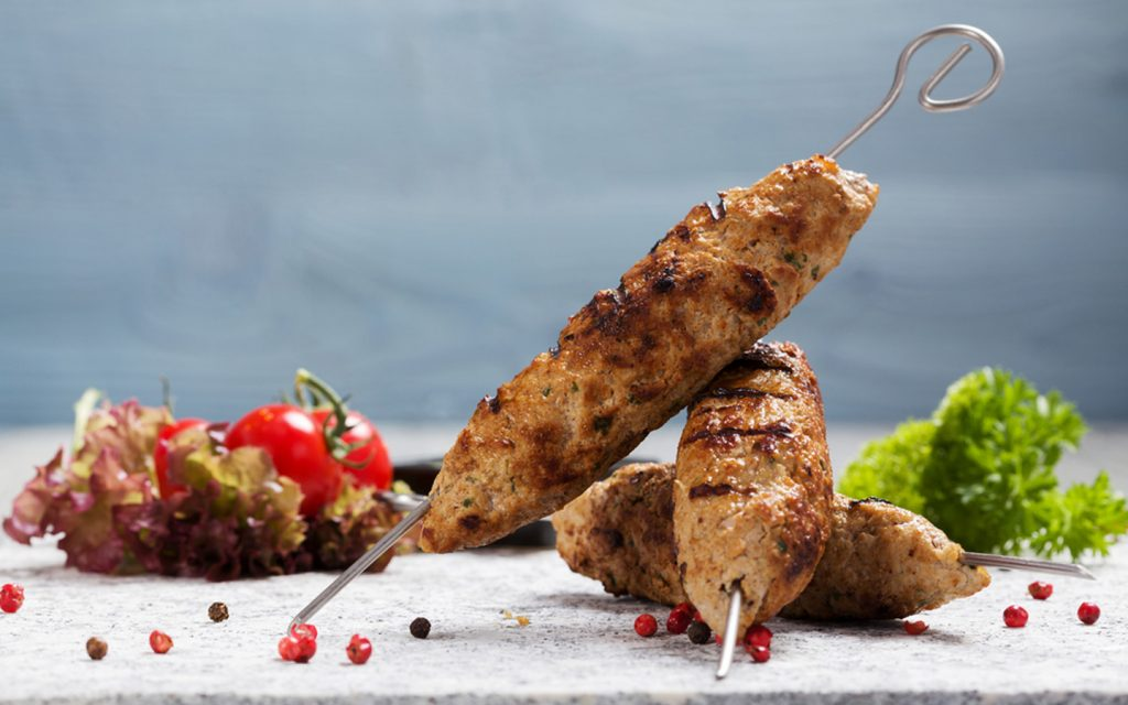Grilled lamb kufta served over  skewers