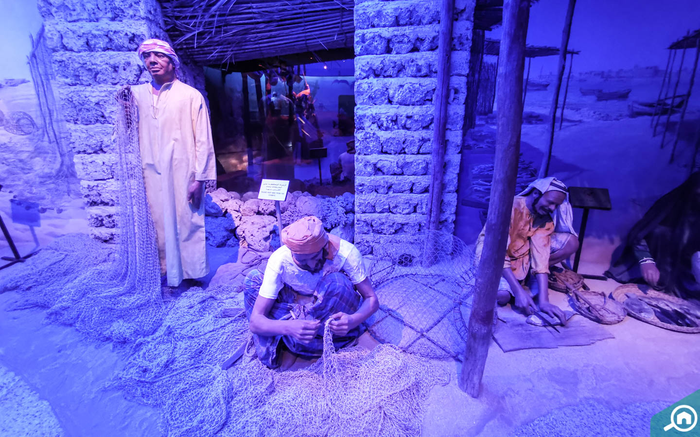 A diorama of fishermen in Dubai port in olden times