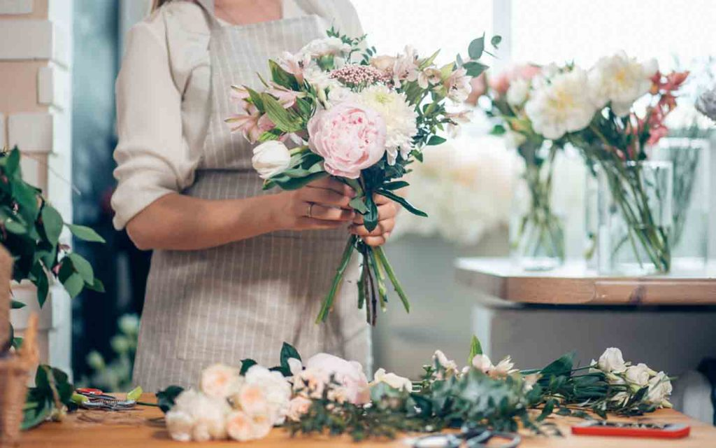 woman making a bouquet at a shop