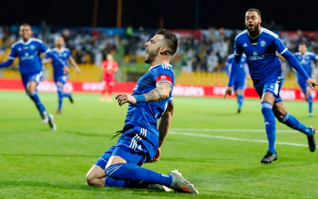 Al Nasr FC player celebrating victory