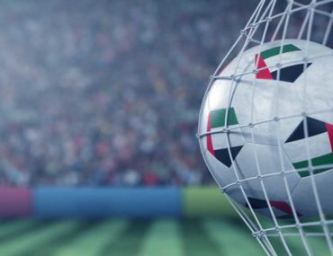 A football with UAE flag on it at the back of the goal