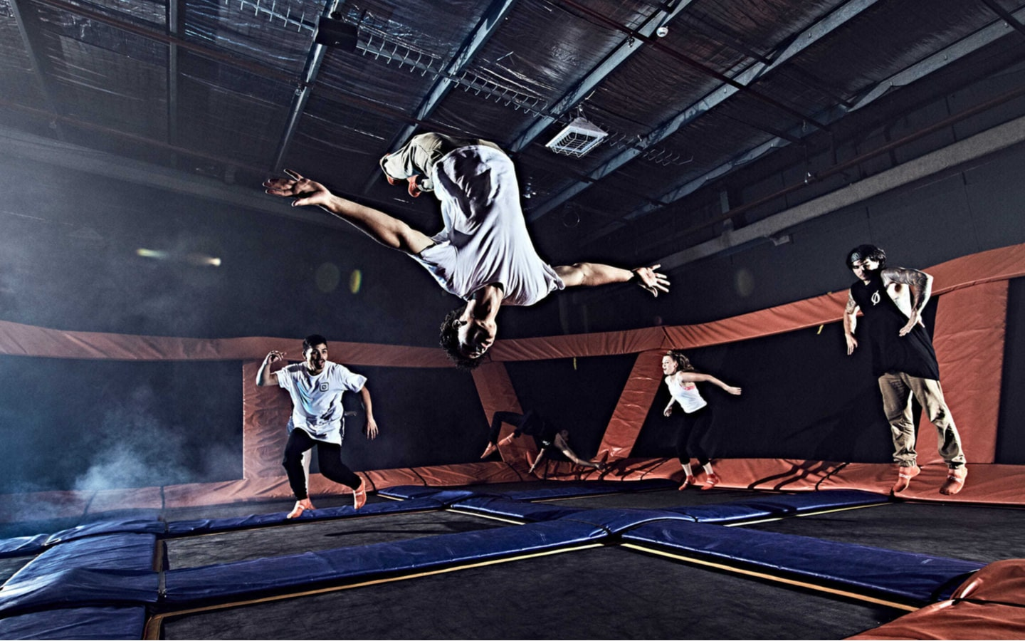 Person doing a back flip at Sky Zone trampoline court