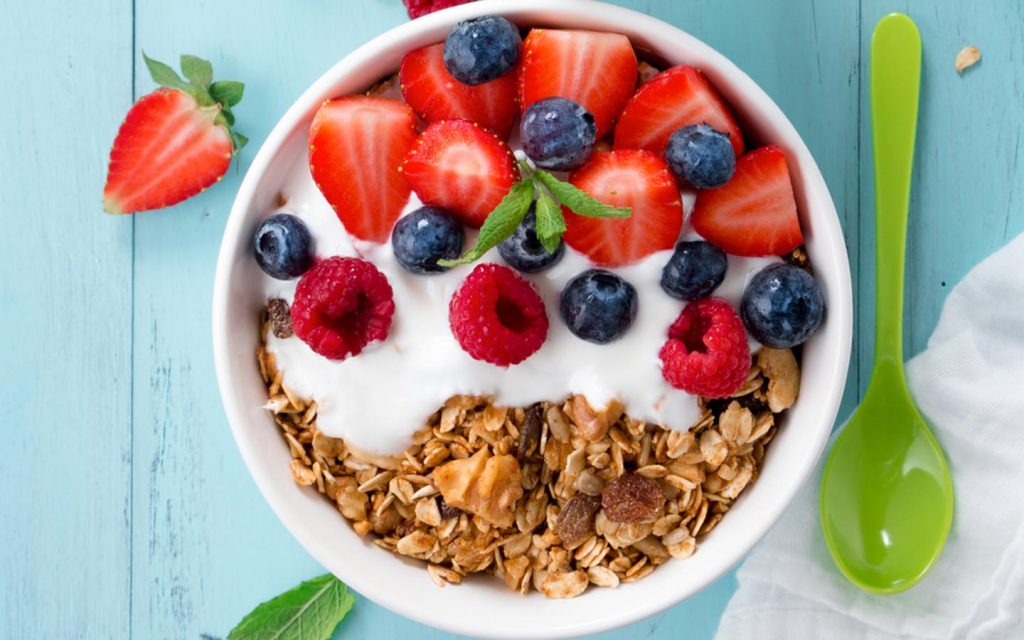Fresh berries make a delicious topping for natural frozen yoghurt