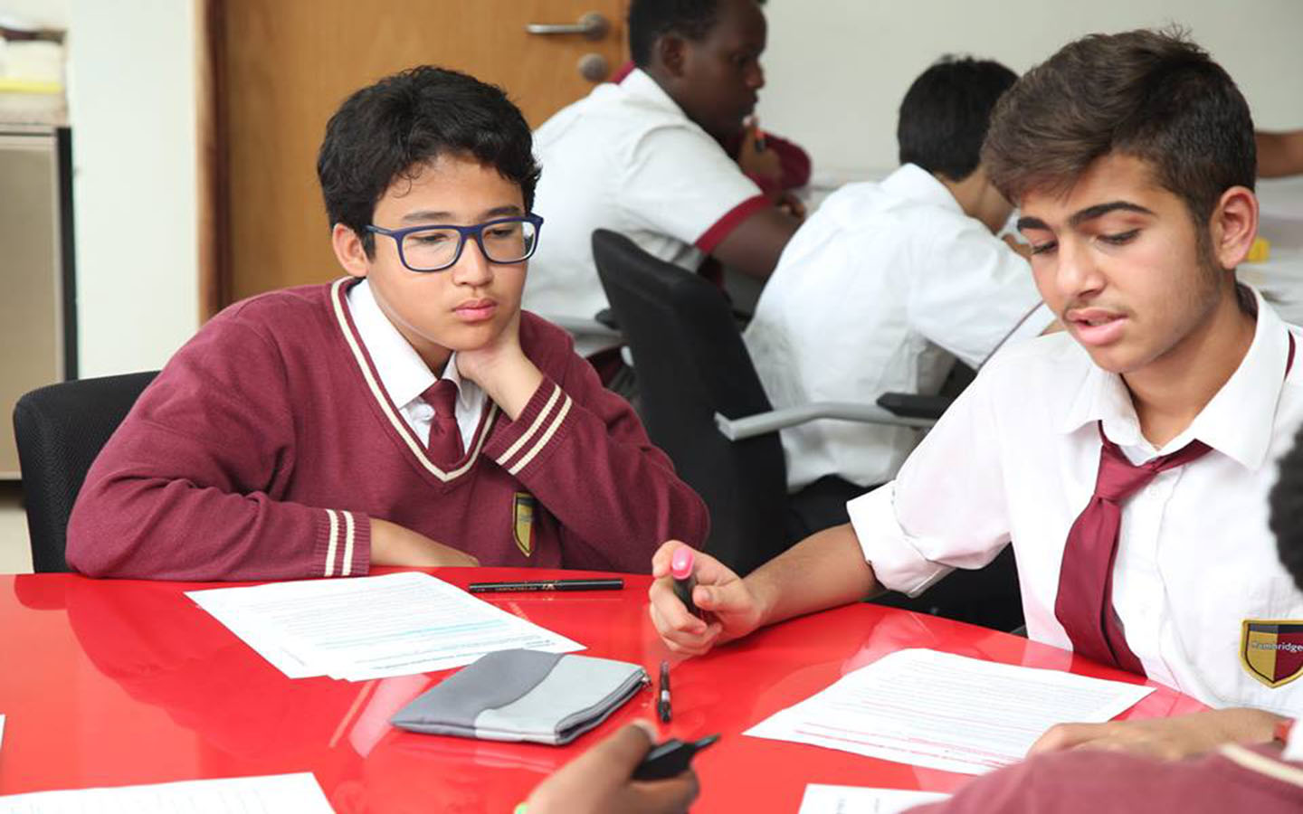 Students discussing ideas with each other at GEMS Cambridge International School)