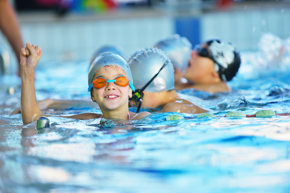 students learning swimming