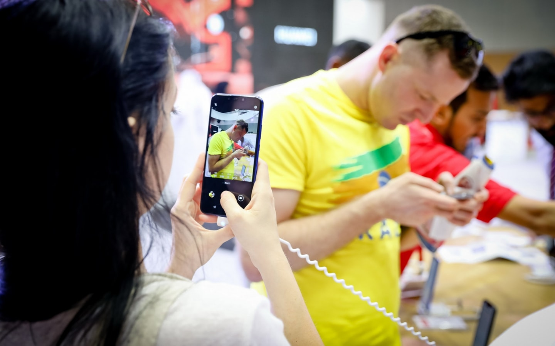 Person using phone during GITEX Shopper 2019