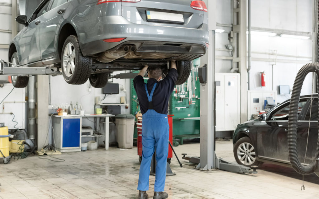 A technician working on a car in one of the top car garages in Dubai