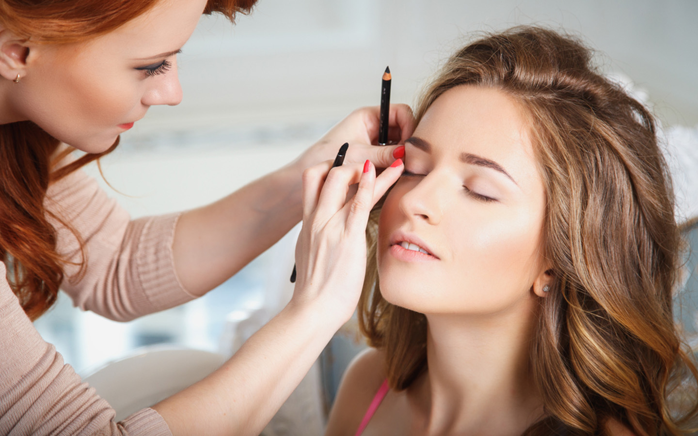 Woman getting a makeover from a professional home service salon expert in Dubai