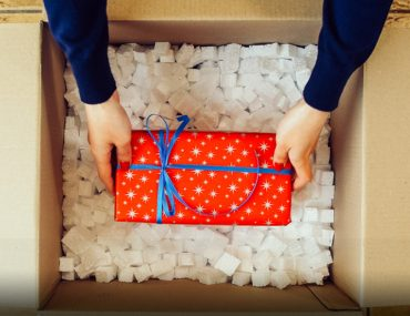 Person lifting gift from a box