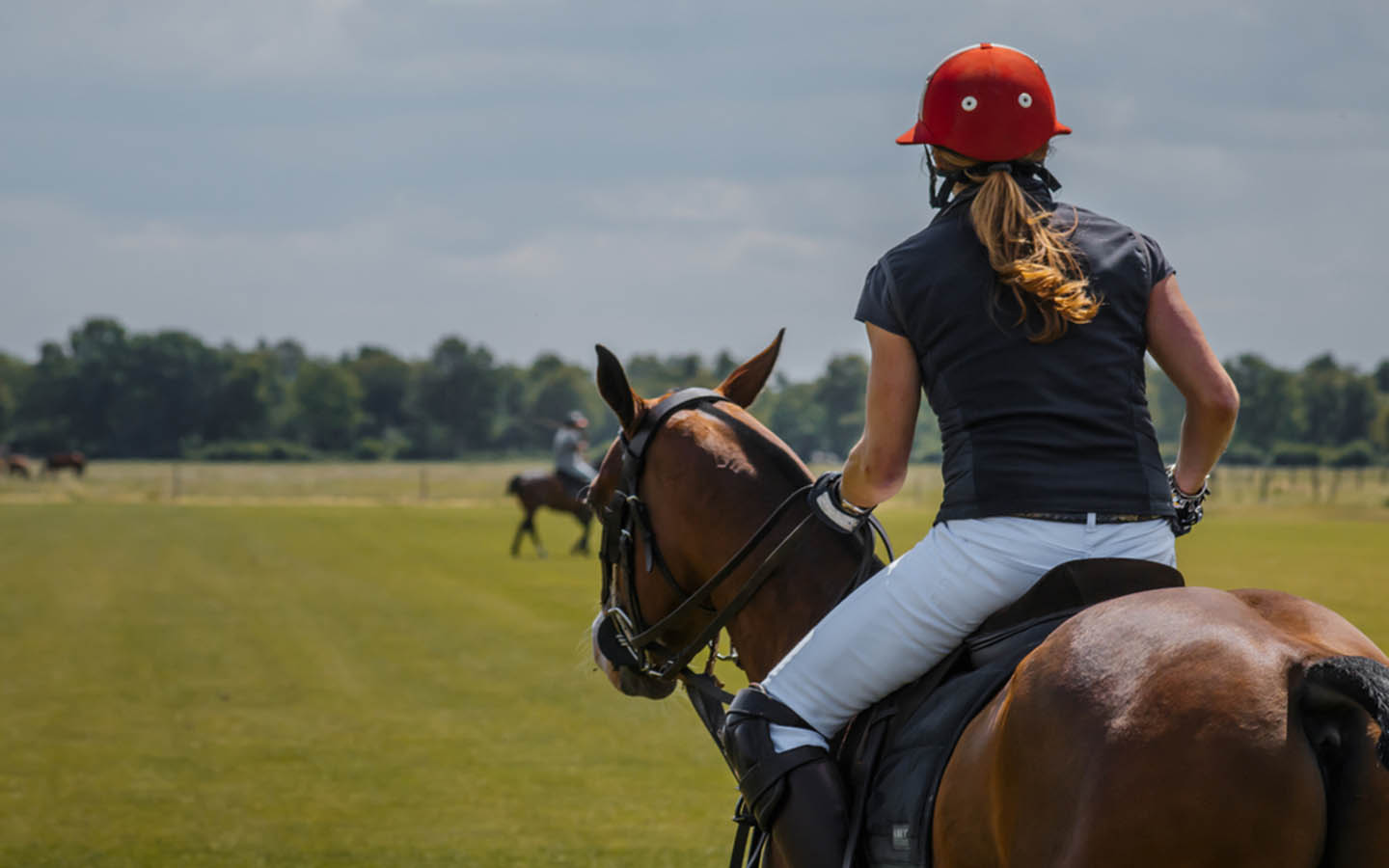 Lady playing polo