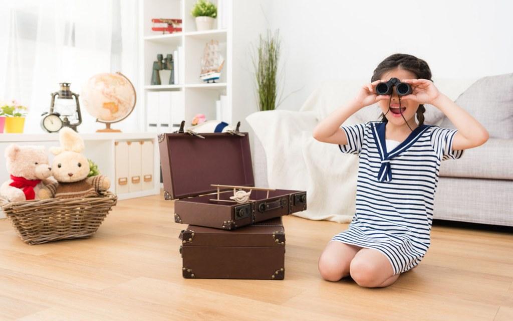 Girl playing with binoculars