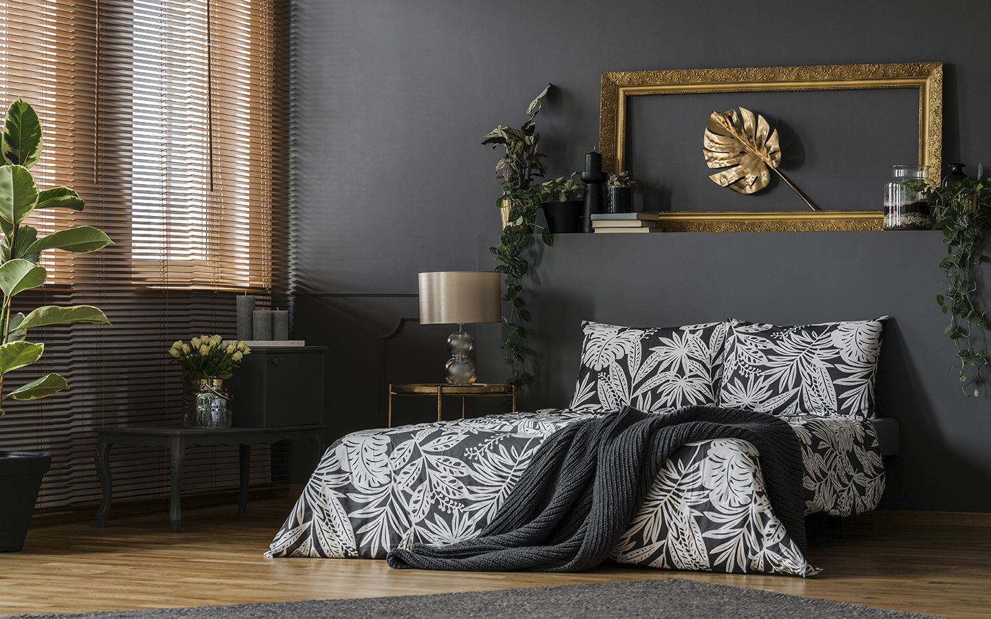 Monochrome bedroom with gold home decor