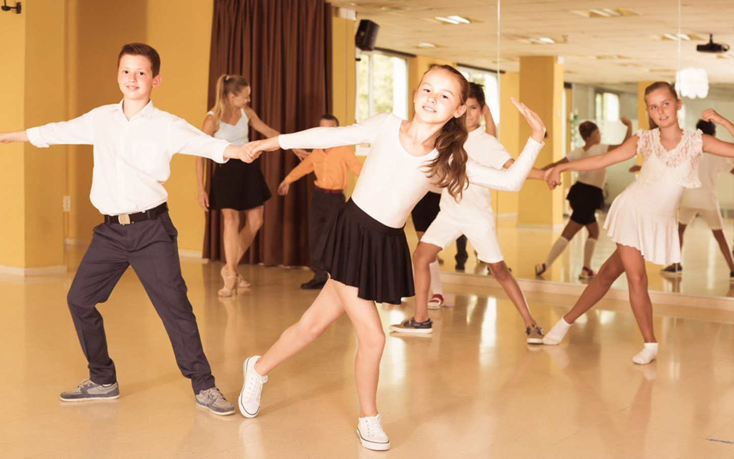 Children with their dance partners at a studio