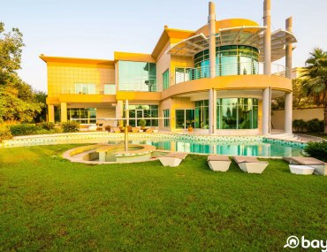 Emirates Hills villa with a beautiful exterior and a swimming pool for sale