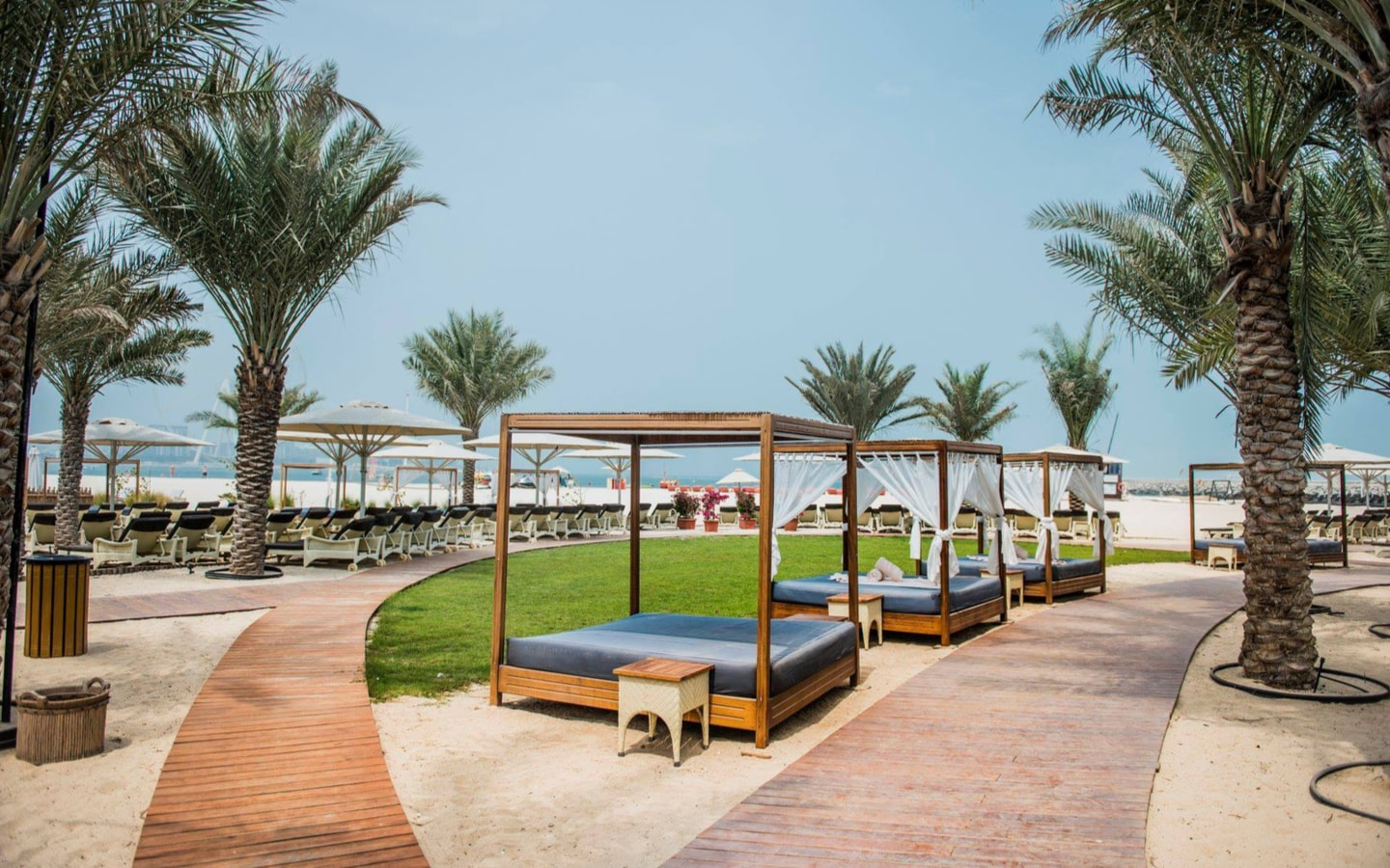 Sunbeds and cabanas at Habtoor Grand Resort, one of the cheaper beach hotels in Dubai
