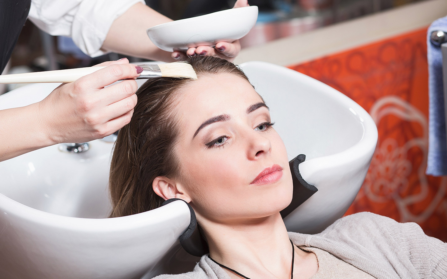 Women's hair being dyed in one of the salons in Dubai