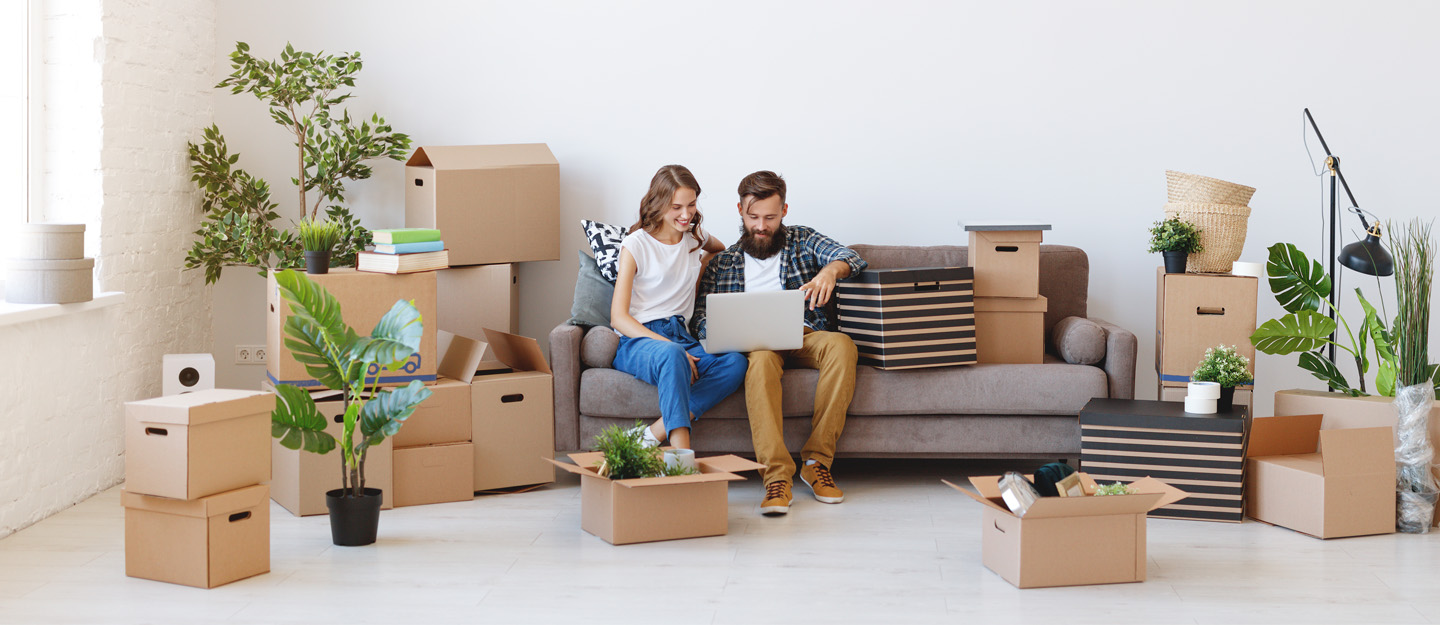 Couple sitting on a couch in their new rental home in Dubai