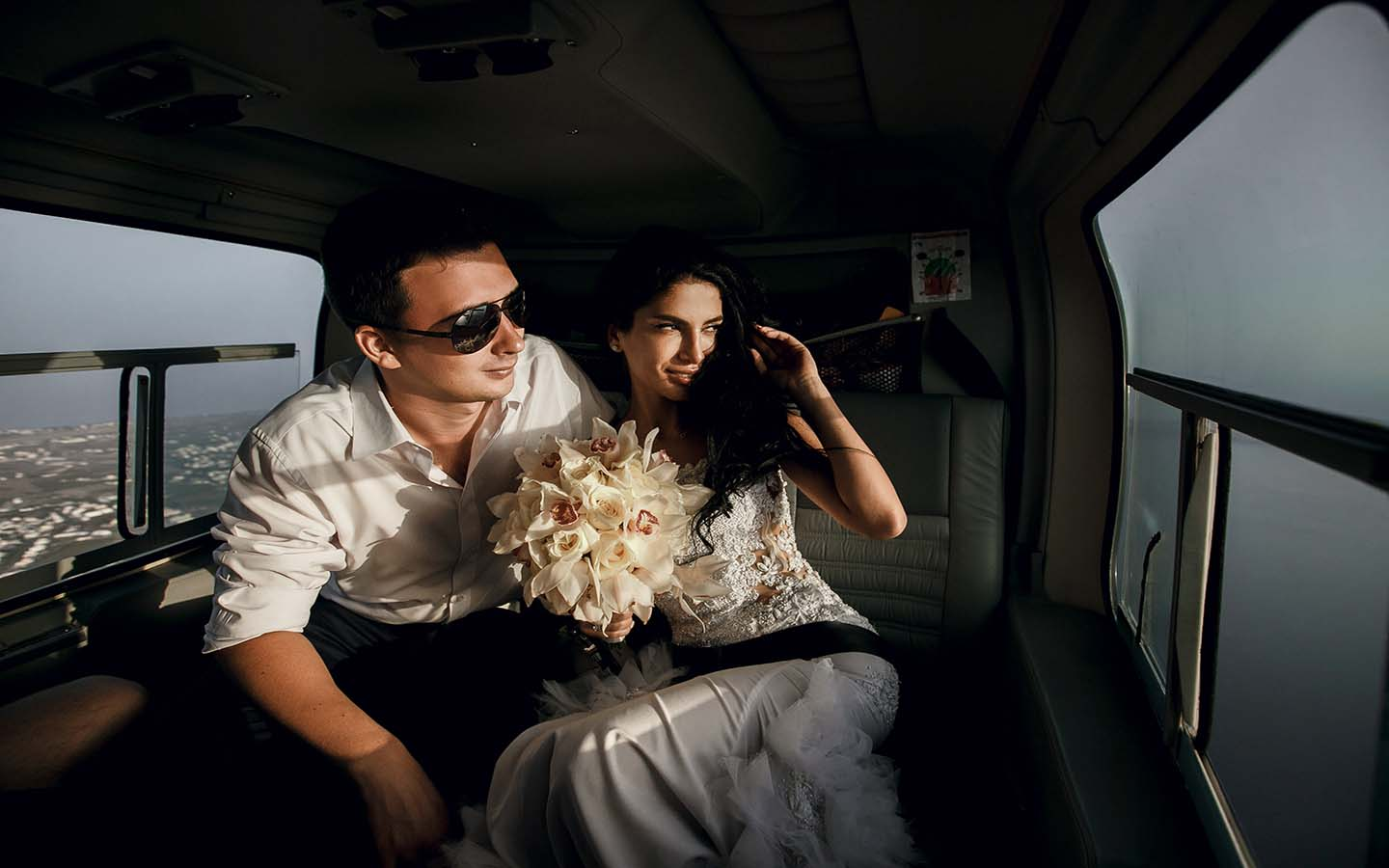 A newly wedded couple on a helicopter