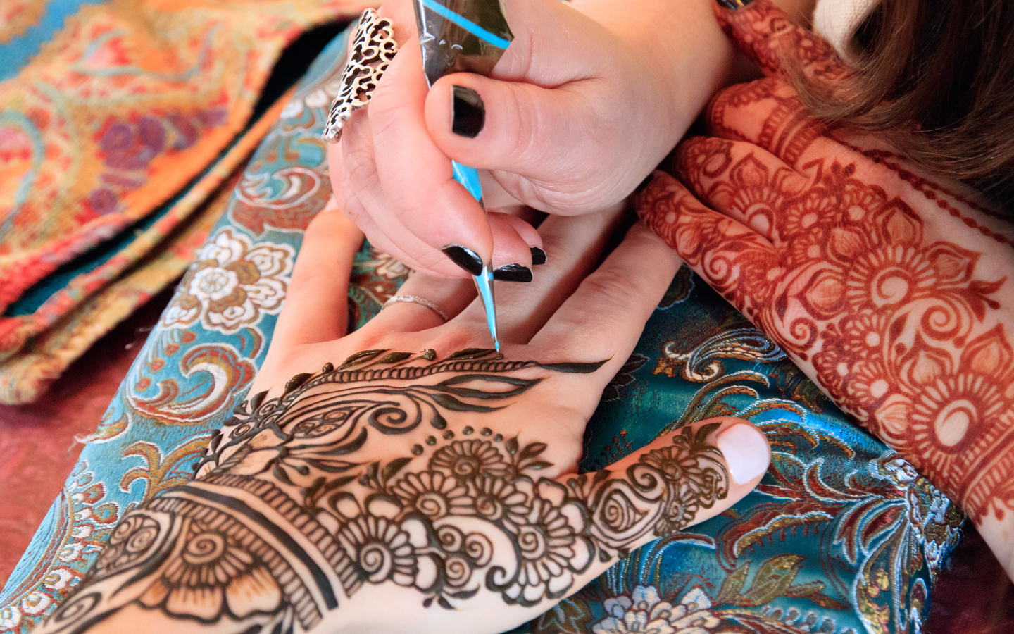 Get beautiful henna designs applied to your hands at TipTop Beauty Lounge