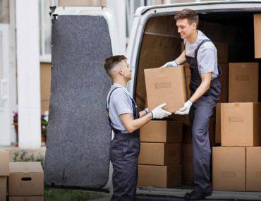 handymen loading items in a truck