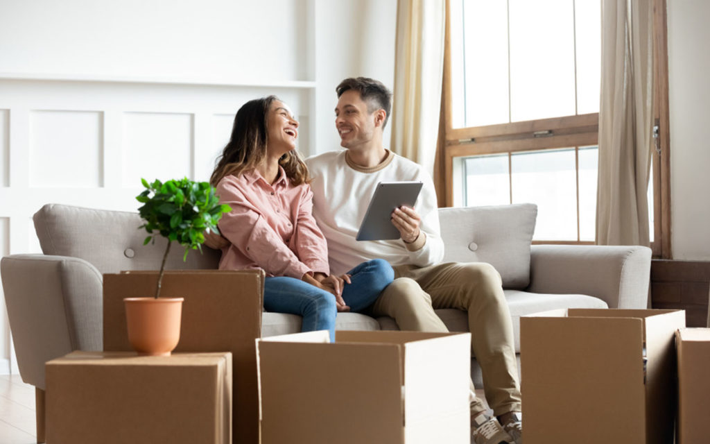 Couple looking happy, using services of moving companies in Dubai