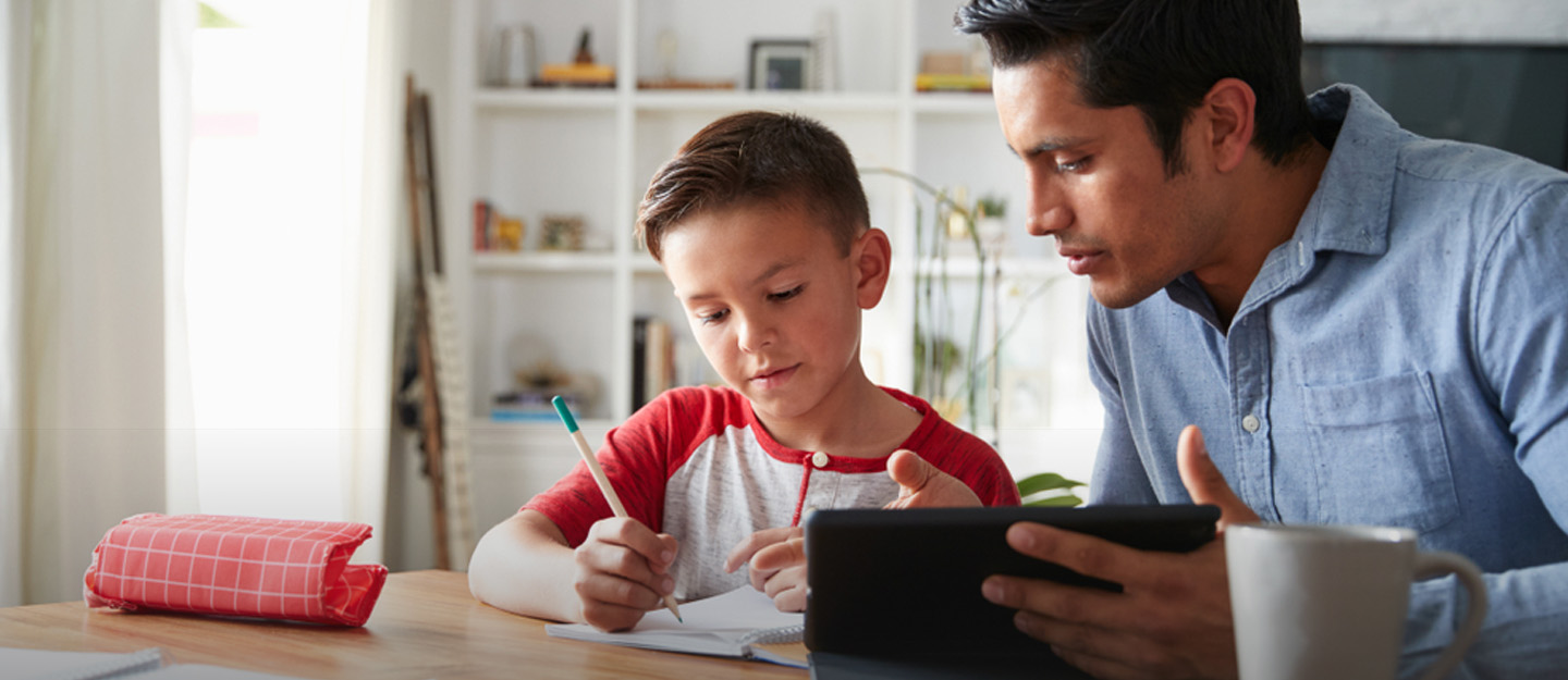 A father teaching his son during a homeschooling in Dubai session