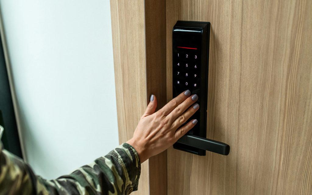 Women entering code on smart door lock