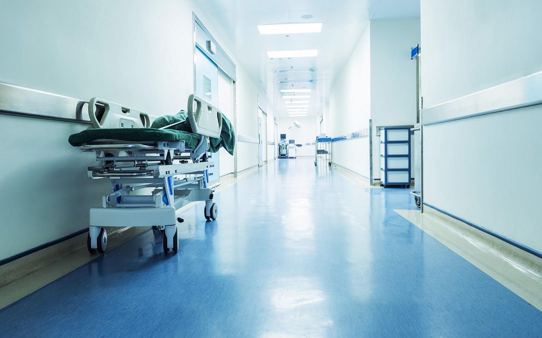 Hospital hallway with an empty stretcher