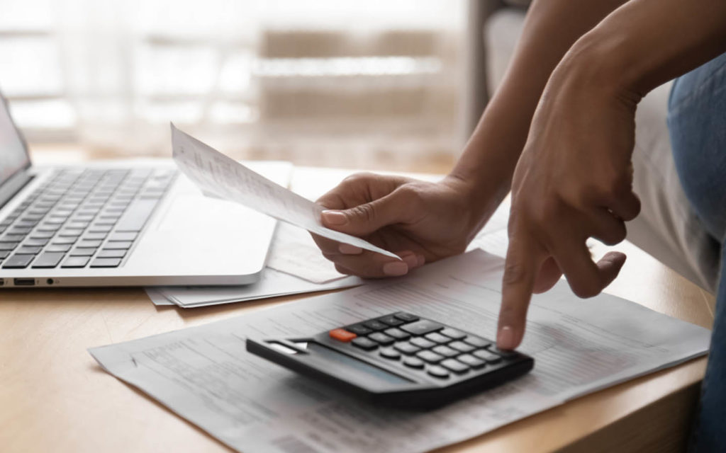 Person doing calculation for Dubai housing fee for owners