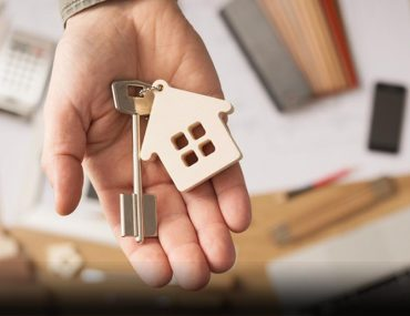 Person handing over keys for off-plan property