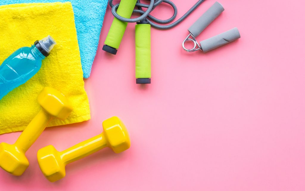 Towel, rope, water bottle, a pair of small barbells and other exercise equipment.