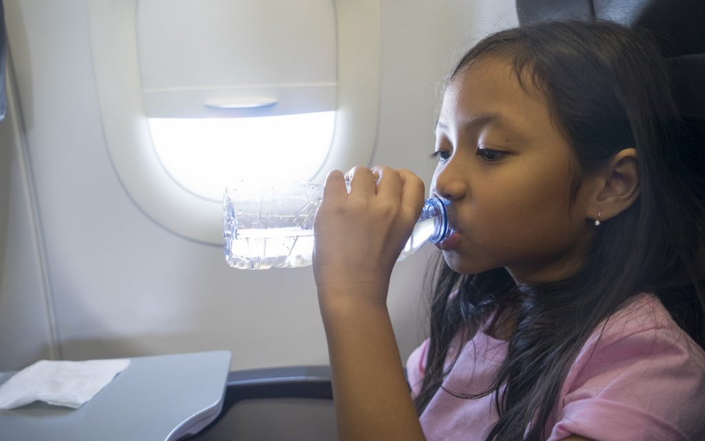 A Filipino child traveling in a plane