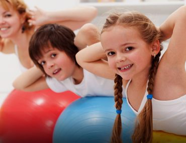 Kids exercises from home with their parent